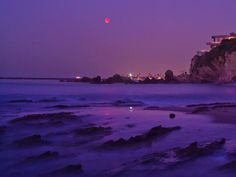 lunar eclipse over Newport beach , CA