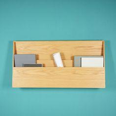Fju desk  German designers Sebastian Schneider and Florian Kallus of KaschKasch created Fju, a wall-mounted wood desk that folds up to reveal storage pockets that act as a discrete and narrow shelf.
