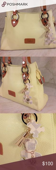 Christina Handbag Pebble Leather - Lt Yellow Christina Handbag Pebble Leather - Lt Yellow - Made in Italy - Vintage Gorgeous purse in pristine condition 100% Authentic Made in Italy  The purse charms come with your purchase this purse. The handmade purse charms and key rings have been styled to compliment this purse. You get: 1 filled teddy bear charm in LV monogram. 3 tassels 2 key rings, crystal beads.  High Quality Pebbled Leather Color: Light Delicate Yellow Roomy Clean and Crisp inside…