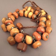 Baltic amber collected in Mauritania. The metal end caps are typical of amber beads from Mauritania. Ethnic Jewelry, Amber Jewelry, Antique Jewelry, Beaded Jewelry, Handmade Jewelry, Jewelry Necklaces, Beaded Bracelets, Jewelry Art, Amber Necklace