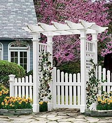 Arbor - backyard landscaping idea (painted the color of the trim on our house where gates are on both sides and then a big one in the back)