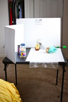 Make your own photo studio with foam board, clips from hardware store and a card table...add some props and get great shots in front of a window.  Gotta try this idea