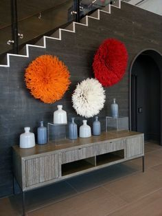 Amazing wall display with 3 Bamileke Feather Headdresses ( Juju hats) in Orange, White and Red