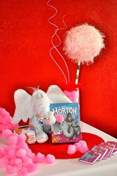 Dr. Suess Party. I love these pink pom-poms!