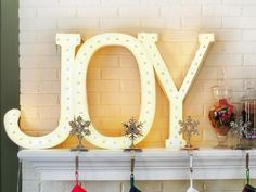 Make your own light-up letters to decorate the mantel! #hgtvholidays  www.hgtv.com/decorating-basics/black-and-white-holiday-decor/pictures/page-16.html?soc=hpp