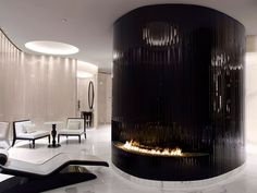 A unique curved burner in @corinthialondon hotel.    #fireplace #interiordesign #architecture #home #homestyle #interiors #love #life #lifestyle #architect #interiordecor #fire #woodburning #woodburner #bespoke #luxury #luxlife #residential #commercial #contemporary #bespokefire #gasfire #modern #innovation