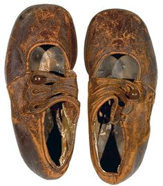 """Pair of leather children's shoes believed to be from Body No. 4, the """"Unknown Child"""".  This very young boy, recovered by the crew of CS Mackay-Bennett, was buried at Fairview Lawn Cemetery in Halifax."""