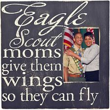 """Designed to hold a x photo, this frame's message honors the powerful place mothers hold in a Scout's life. Painted wood frame features distressed background and text for a decorative, """"vintage"""" appearance. Includes a kickstand back for Scout Mom, Girl Scout Swap, Girl Scout Leader, Cub Scouts, Eagle Scout Gifts, Eagle Scout Cake, Brownie Girl Scouts, Scout Store, Eagle Scout Ceremony"""