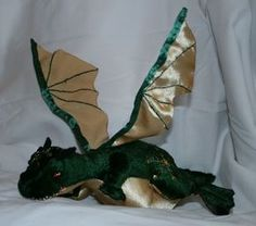 While JD and I were visiting his relatives last week, I mentioned to my sister-in-law, R (JD's brother's wife), that I'd been thinking about making a stuffed toy dragon. R thought this sounded like a fun idea and offered me the use of her sewing machine and stash of fabric scraps. I drafted a…
