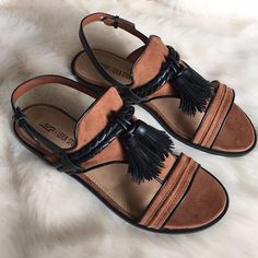 Brown & Black Suede Tassel Sandals New in box. Only tried on in house. Brown faux suede with black faux leather. Black fringe tassels in front. Adjustable ankle strap. ❌NO TRADES OR PAYPAL❌ Leila Stone Shoes Sandals