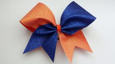 Orange and royal blue glitter cheer bow. Ask about bulk discounts, color and mascot options. by bragabitbows. Explore more products on http://bragabitbows.etsy.com
