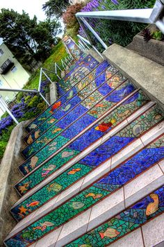 """AMAZING MOSAIC TILED STAIRCASE IN SAN FRANCISCO. An amazingly detailed mosaic set of 163 steps (the """"tiled steps"""") is covered with beautifully patterned tiles from all around the neighborhood of 16th Avenue with the help of more than 300 local neighbors. The beautification work was sponsored by San Francisco Parks Trust in 2003. Located between 16th Avenue & Moraga, it took 1½ years to complete & is adorned with thousands of amazing name, animal & patterned tiles from around the city."""