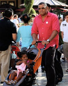 Actor Laurence Fishburne strolls with daughter Delilah in the City Mini Single.