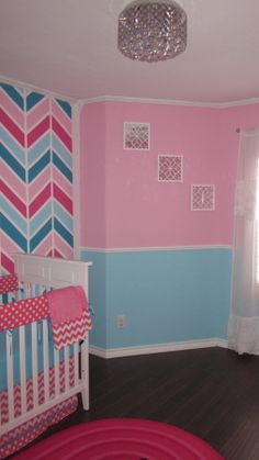 Peytons Chevron Nursery, Turquoise and Pink palette with a chevron accent wall for baby girl.  , Light fixture from overstock.com, rug from target. , Nurseries Design