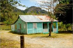 Dominican Republic wooden humble homes.  Still paradise...