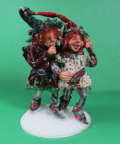 """Helen Hartzell - ooak hand sculpted polymer clay, 2 elves """"Naught and Nice"""", dressed in red, green and white suede; sold on ebay for $113.39"""