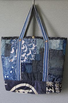 Boro tote bag , made of japanese indigodyed katazome cotton,vintage japanese kasuri and japanese noragi textile, with a lot of vintage japanese