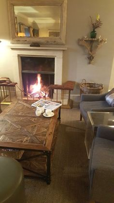 Coffee and newspapers by the fire at Calcot Manor. The perfect way to relax and escape from the cold http://www.calcotmanor.co.uk/