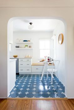 Limited given the small size of the kitchen, Waters made adjustments where she could. By shifting the entrance right from the dining room, the designer allowed for a longer span of cabinets on one wall.