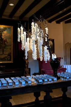 hanging floral tree over escort card table