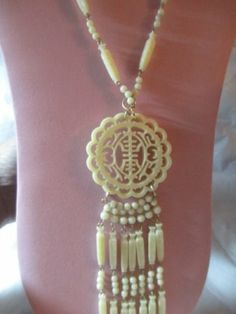 ENDING SHORTLY! Carved Lucite Faux Ivory Oriental Chinese Pendant Necklace on Wires Vintage   eBay