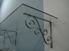 Though old throughout strategy, the pergola has been having a bit of a modern rebirth Wrought Iron Decor, Iron Wall Decor, Iron Furniture, Deco Furniture, Grill Design, Iron Art, Shelf Brackets, Metal Crafts, Metal Walls