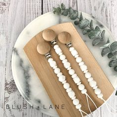 Claire, our white monochromatic pacifier clip representing purity is perfect for any baby girl. Length: Easy to clean with water and mild soap. Baby Diaper Bags, Baby Bibs, Baby Teethers, Sweet Peach, Baby Gift Sets, Carters Baby Girl, Mild Soap, Baby Accessories, Food Grade