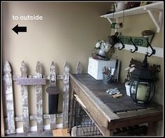 love the old fence, the card catalog used to hold tools, old lamp post top. and rustic table with slate tile top