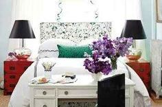 red tables/black lamps/pale blue walls/statement headboard