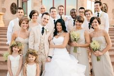 The entire wedding party in light neutral colors - very pretty - crisp