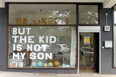 """Window decoration made of cardboard letters, the text """"But the kid is not my son"""" is a line from the song """"Billie Jean"""" by Michael Jackson Karaoke, Cardboard Letters, Shop Window Displays, Valentine's Day Diy, Window Design, Glass House, Valentines Diy, Shop Signs, Vintage Shops"""