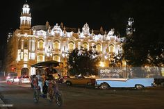 Pedicabs and 1950-era American cars mix in front of the Gran Teatro de La Habana, or the Grand Theater, January 19, 2015 in Havana, Cuba. The United States is sending a delegation from the State Department to Havana this week to continue talks to normalize relations between the two nations.