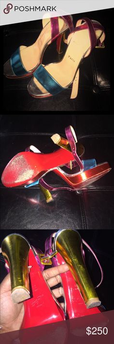 💯 percent Authentic CL sandals Blue red gold and pink super cute shoe! No box! No bag! Authentic! Worn like 5 times as you can see on bottom. Only damage is slight scuffs on heels that you can not see while wearing (insides of shoes) Fit like 7.5 Christian Louboutin Shoes Heels