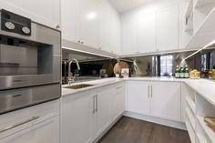 Dea Jolly: What's trending in kitchen design right now – Domain Kitchen Mirror Splashback, White Shaker Kitchen, White Marble Kitchen, White Kitchen Backsplash, Kitchen Cabinets, White Kitchens, The Block Kitchen, Open Plan Kitchen, Kitchen Living