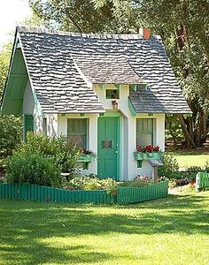 Is this little cottage charming or what? This would be cute for a child's clubhouse