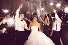 Sparkler sendoff for the bride and groom! I really like this idea, but i'm too paranoid about my dress or hair catching on fire.. that WOULD be my luck