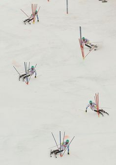 Felix Neureuther of Germany is seen in a multiple exposure clearing slalom gates during the season's last race at the men's Alpine Skiing World Cup finals in Lenzerheide March 17, 2013. REUTERS/Pascal Lauener