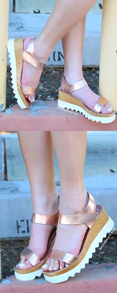 """Calling all edgy girls! Your summer savior is here! The Metallic Faux Wood Sole Flatforms feature an open toe, metallic PU upper, faux wooden hybrid sole, and adjustable velcro ankle strap. Finished with a slightly padded insole and 2.5"""" heel approx. Team with a crop tee and boyfriend jeans for a laid back ensemble."""
