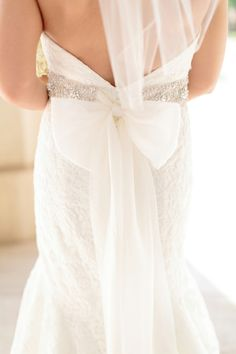 Love the bow on the back of this gown. Photo by Amanda Watson Photography. www.wedsociety.com #weddinggown #bow