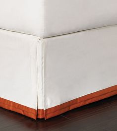Dean Parchment Bed Skirt with Orange Double Pleat. Indira by Eastern Accents