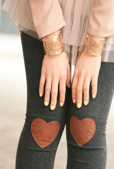 heart-shaped knee patches on tights.