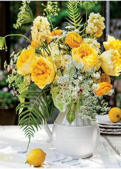 Vibrant yellow roses, ranunculus, and other yellow blossoms create a sunny and seasonal centerpiece. Add a touch of Queen Anne's Lace for a subtle complement to this citrus-inspired bouquet. Find tips on creating this arrangement here. Green Flowers, Summer Flowers, Yellow Flowers, Amazing Flowers, Beautiful Flowers, Simple Flowers, Shabby Flowers, Yellow Flower Arrangements, It's All Happening