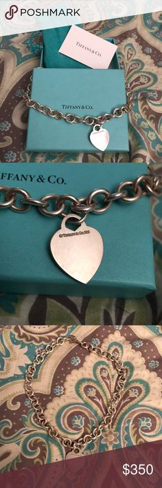 Tiffany Heart Charm Necklace EUC. Tiffany & Co. Heart charm necklace. Needs to be polished. Box, bag and silver care card included. All original packaging. Tiffany & Co. Jewelry Necklaces