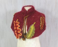 Cosy scarf with autumnal leaves Over outerwear Capelet Funny neck warmer Claret Colorful Crochet Knit Birthday gift Impressive For her Unique knitted capelet decorated with big colorful flowers and green leaves. The capelet is made of claret mohair yarn. The leaves are crocheted of colorful yarn. Please check size (below).  The roping (with thin crochet rope) let you adjust width near neck. The roping is ended with two handmade acorns.  You can wear this scarf over the outerwear or over her…