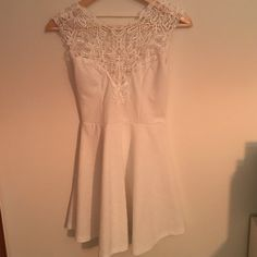 Beautiful white dress This dress is gorgeous the details is amazing. Lace front and open back with a bow. Very flattering. Worn once amazing condition. Mulata Dresses Mini
