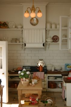Love, love the white subway tiles! She explains in detail how she did them - and all her mistakes