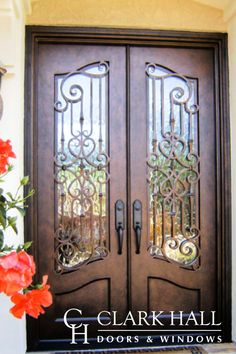 The ornate style of these custom iron front entry doors transforms the entire design of the home's entrance. With large glass windows to let in the natural light, these custom made double doors take all of your exterior double door ideas to the next level. Main Door Design, Front Door Design, Wood Entry Doors, Entrance Doors, Iron Front Door, Front Doors, Front Entry, Wrought Iron Doors, House Doors