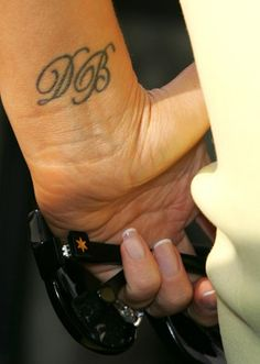 Victoria Beckham wrist initials Tattoo facing the right way. I didn't even think about which way to face it!!