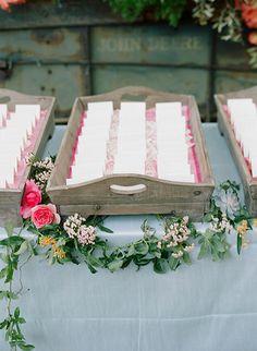 cute escort card table with wooden trays #escortcards #weddingreceptions #weddingchicks http://www.weddingchicks.com/2014/02/05/dos-pueblos-ranch-wedding-2/