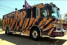 "Purple and gold fire truck belonging to LSU DEFTI (Fire and Emergency Training Institute). These are the school's official colors. The school's mascot is the ""Tigers,"" which explains the painted pattern / design. #lsu #fire #truck #purple #gold"